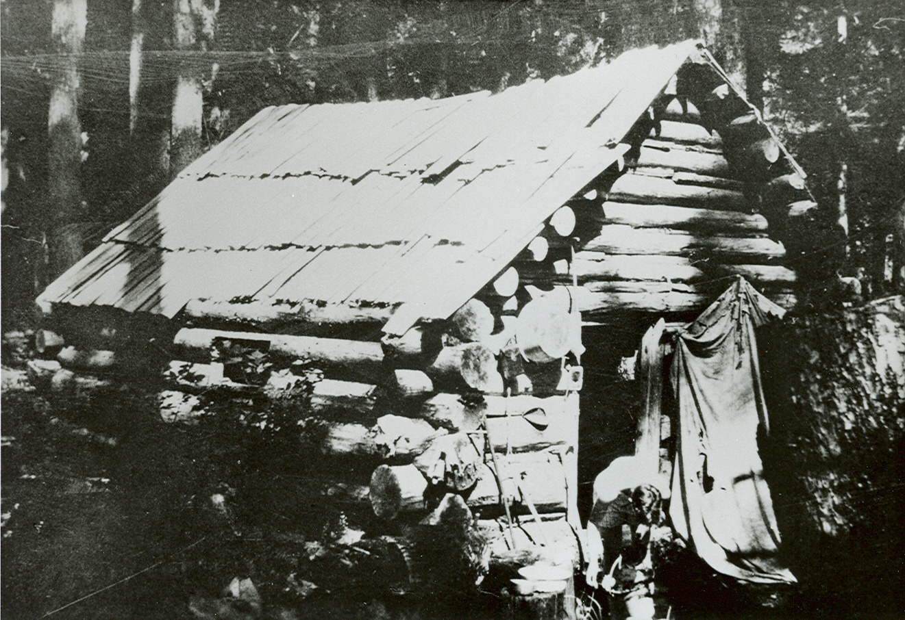 Photo of a log cabin.