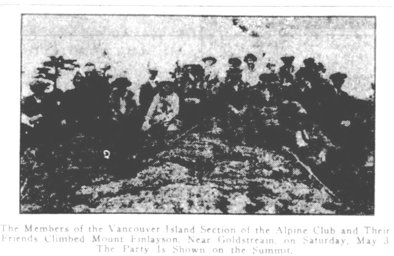 Grainy photo of the Mount Finlayson climbing party on the summit.